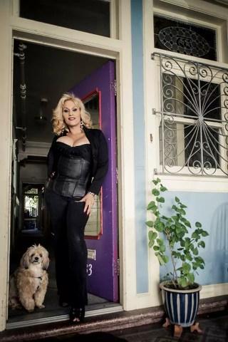 Alejandra Cruz in her doorway with her dog