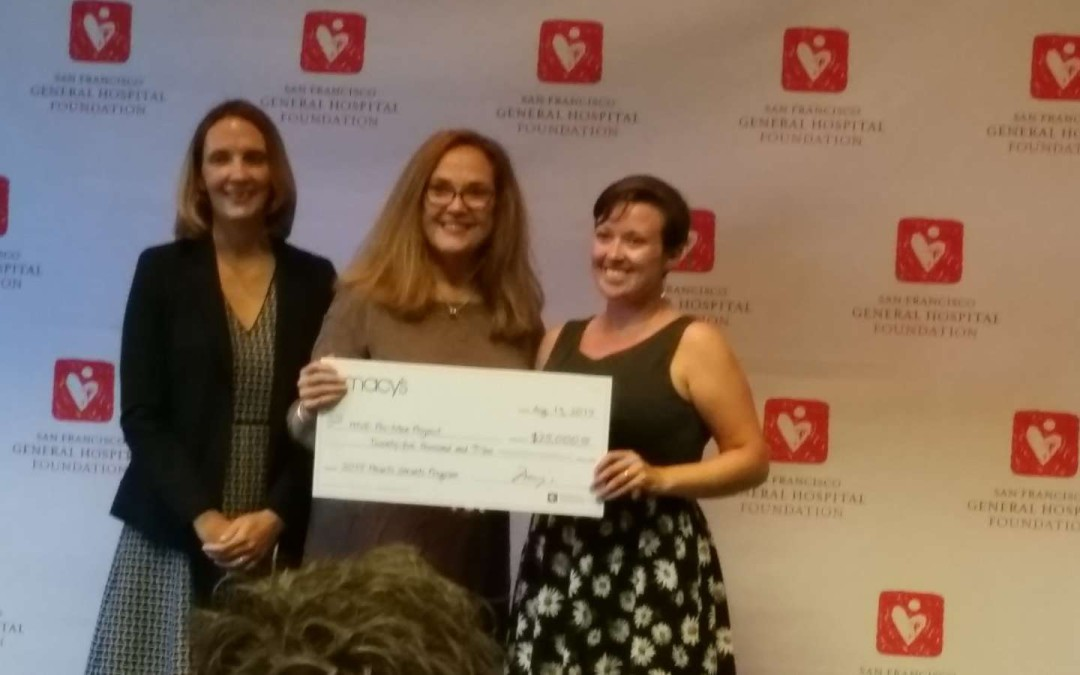 Caroline Watson accepts a Heart Grant check for HIVE