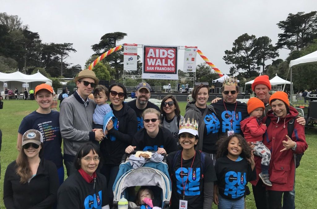 a group of people smile at the AIDS Walk