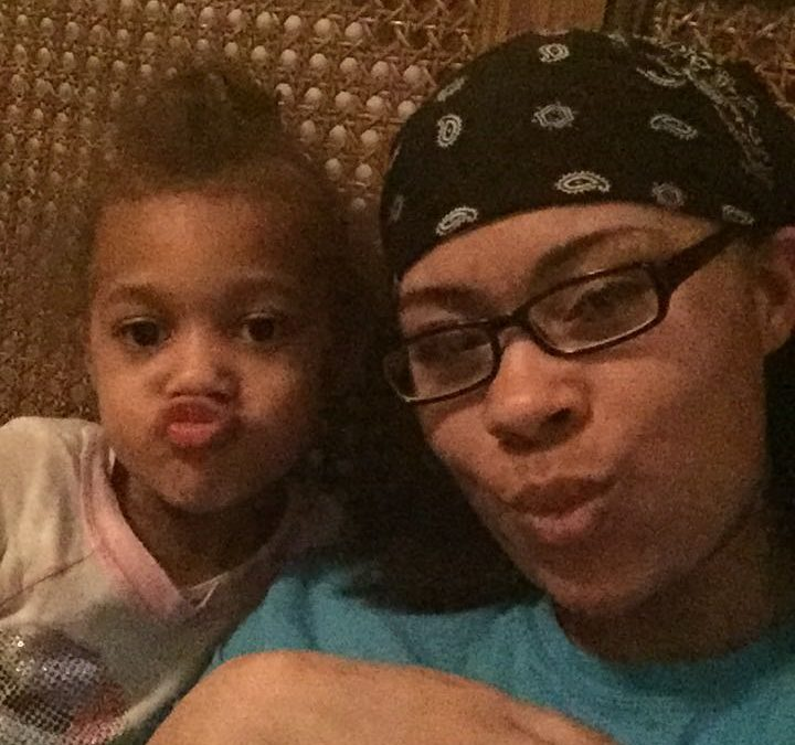 A Black mom and her daughter make silly faces at the camera